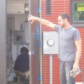 Dan Handeen shows us the energy meters.