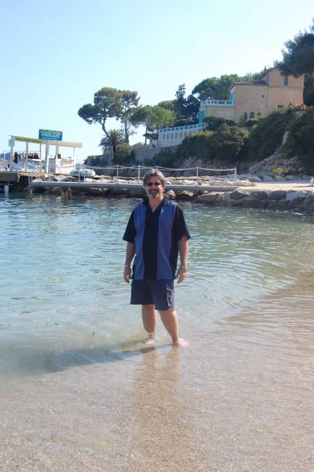 Mike dipping his feet in the Mediterranean Sea.