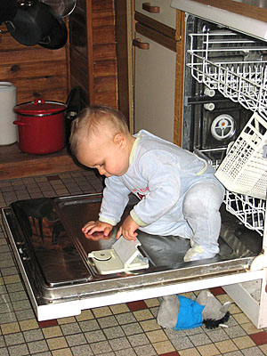 "So easy, a baby could fix it! (I know, cheap excuse to indulge my ""photos of babies playing in appliances"" habit.)"