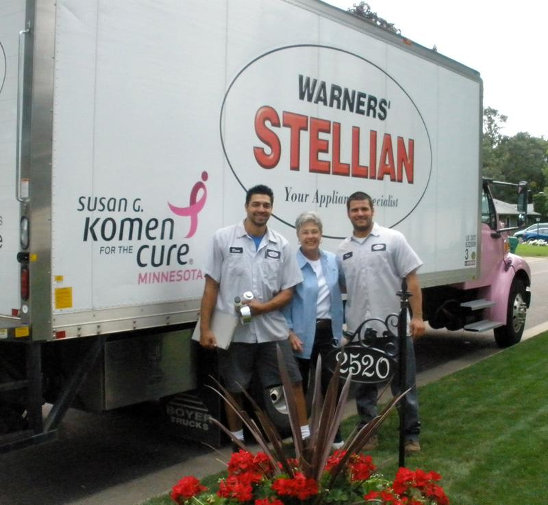 Two-time survivor and longtime local Komen for the Cure Affliate supporter Nancy poses in front of the Warners' Stellian's Think Pink delivery truck with crew members Dave and Tom.