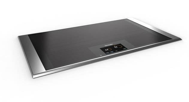 The new Thermador Freedom Induction Cooktop heats up your cookware wheverer you place it  - no burners.