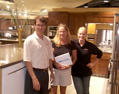 From left: Jonathan Smart of Bosch, Mary Lou and I pose in the Bosch display at Warners' Stellian Edina with Mary Lou's new iPad!
