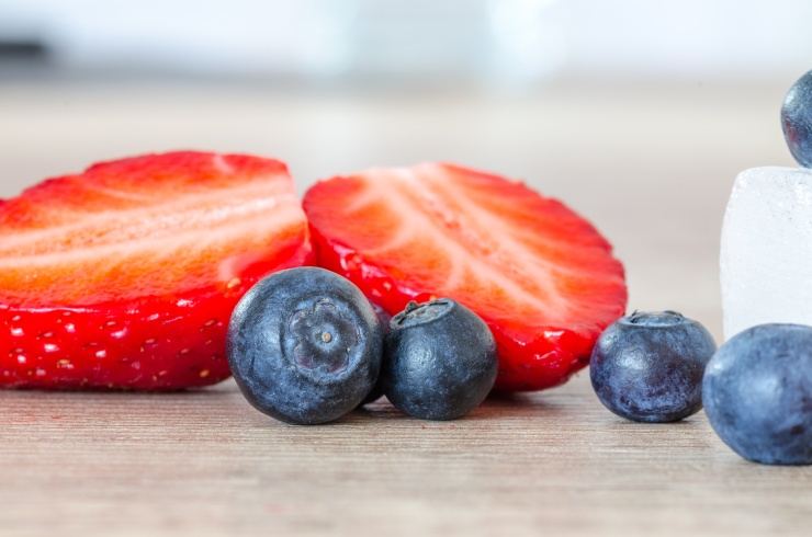 sliced strawberry and blueberries